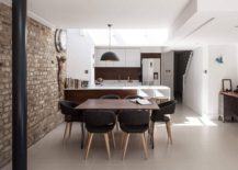 Large pendant above the kitchen counter gives the living area an industrial vibe