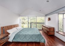 Large-windows-and-skylight-bring-ample-light-into-the-bedroom-217x155