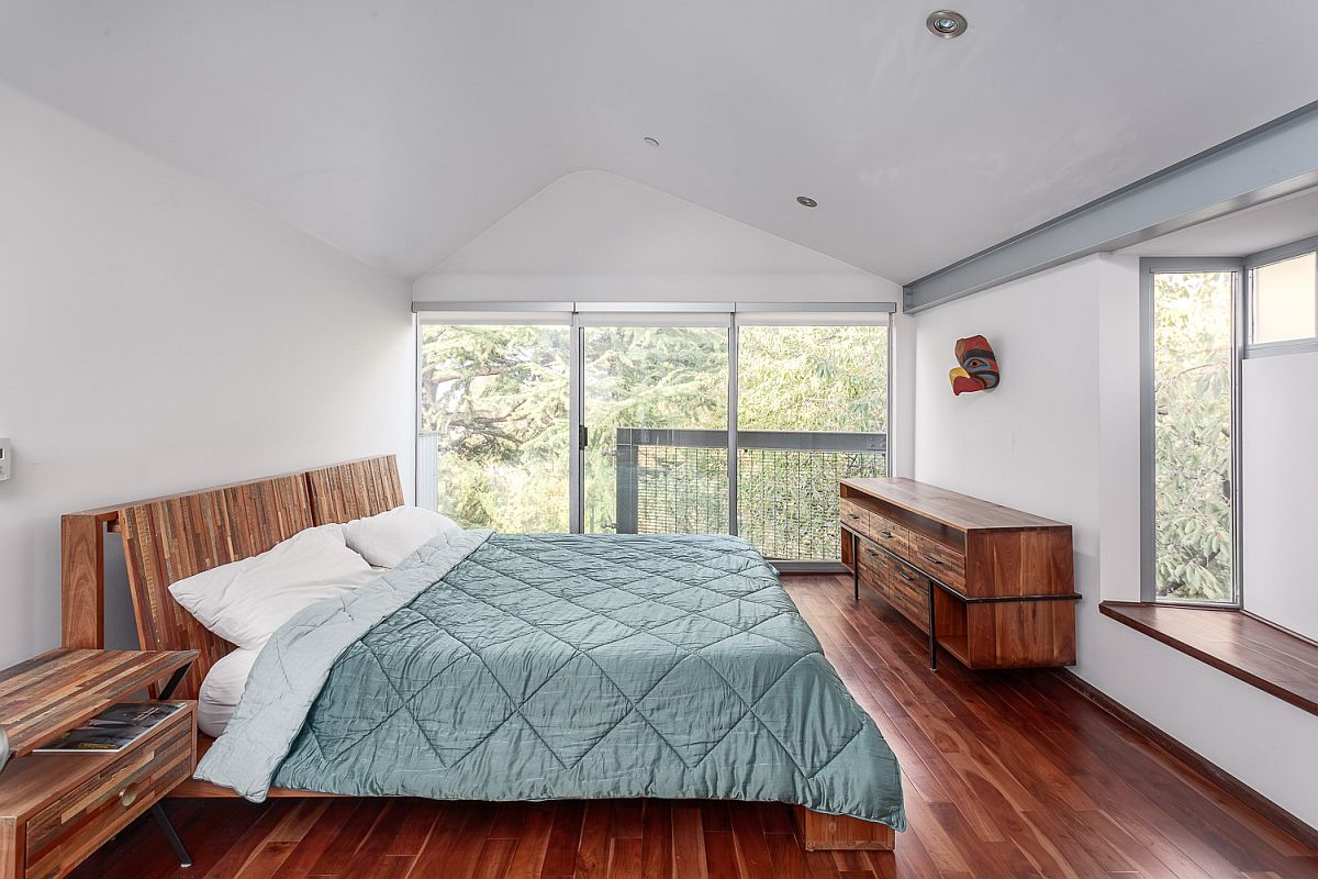 Large windows and skylight bring ample light into the bedroom