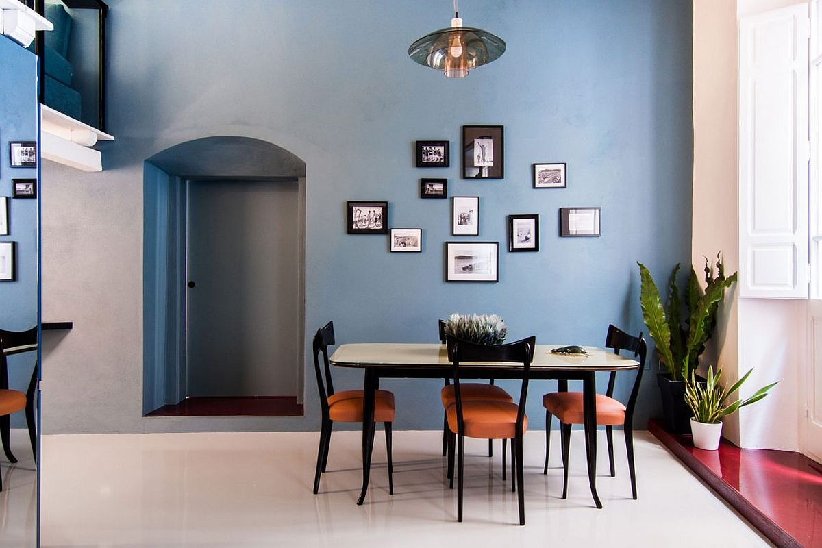 Light blue walls in the dining room create a sense of relaxed spaciousness