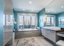 Light-filled contemporary bathroom in blue and gray
