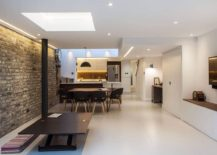 Light-filled living area of the London home with kitchen and dining space