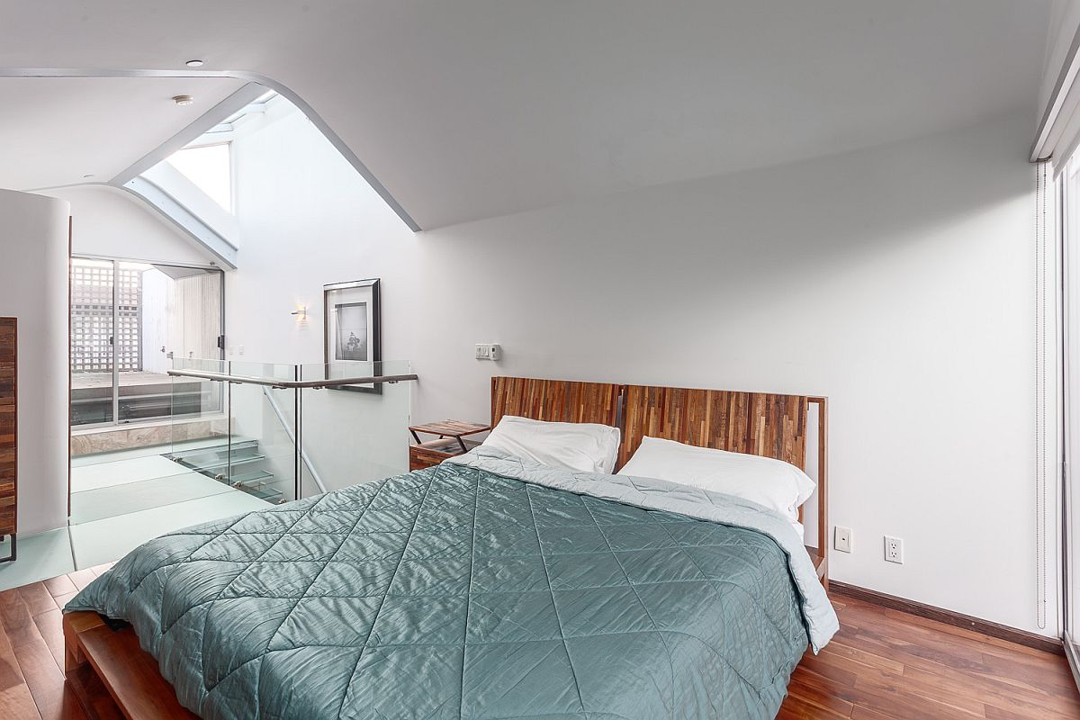 Loft bedroom with space-savvy design inside the Vancouver home