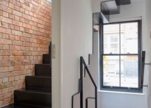 Metallic-staircase-leads-to-the-master-suite-on-the-top-level-217x155