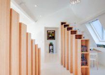 Mezzanine-level-beech-shelving-units-hide-the-bedroom-entrance-217x155
