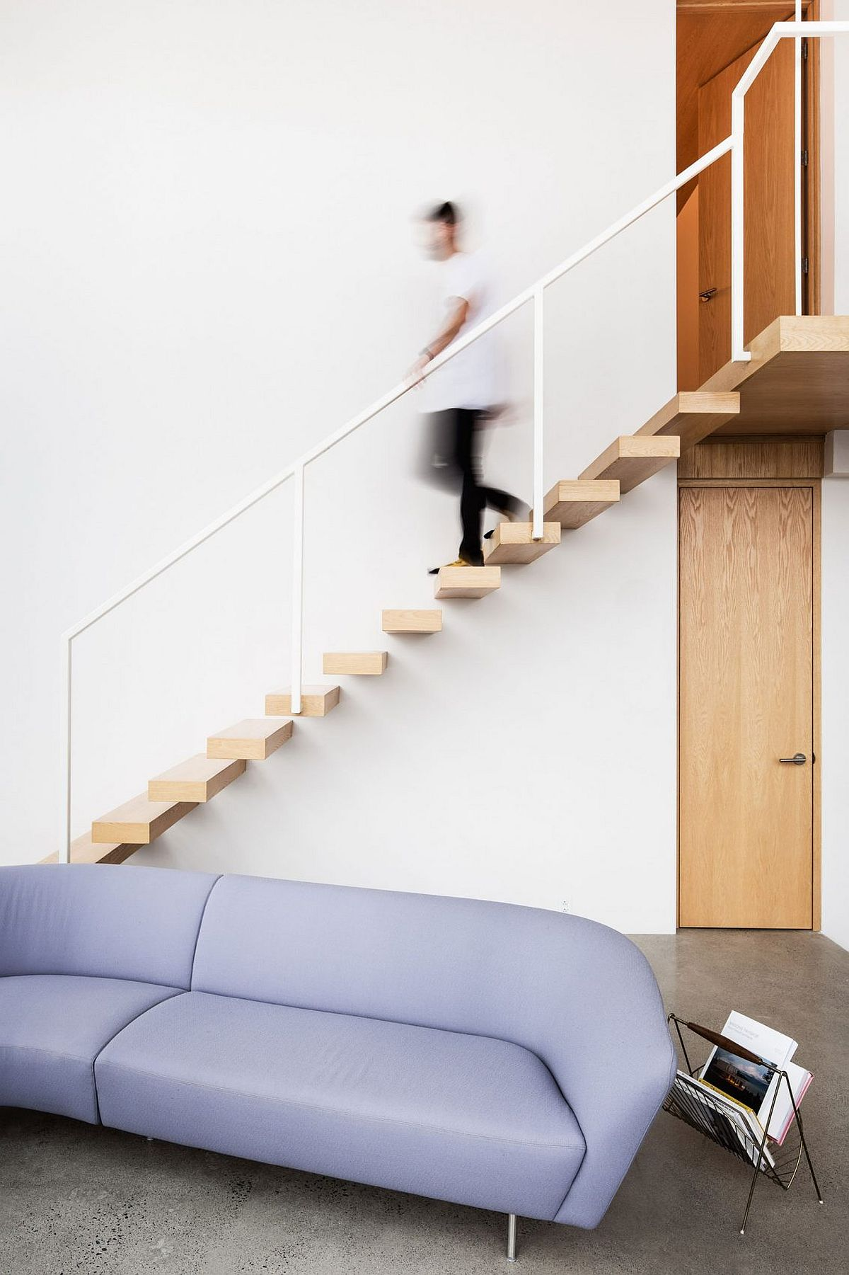 Minimal floating stairway with wooden stairs