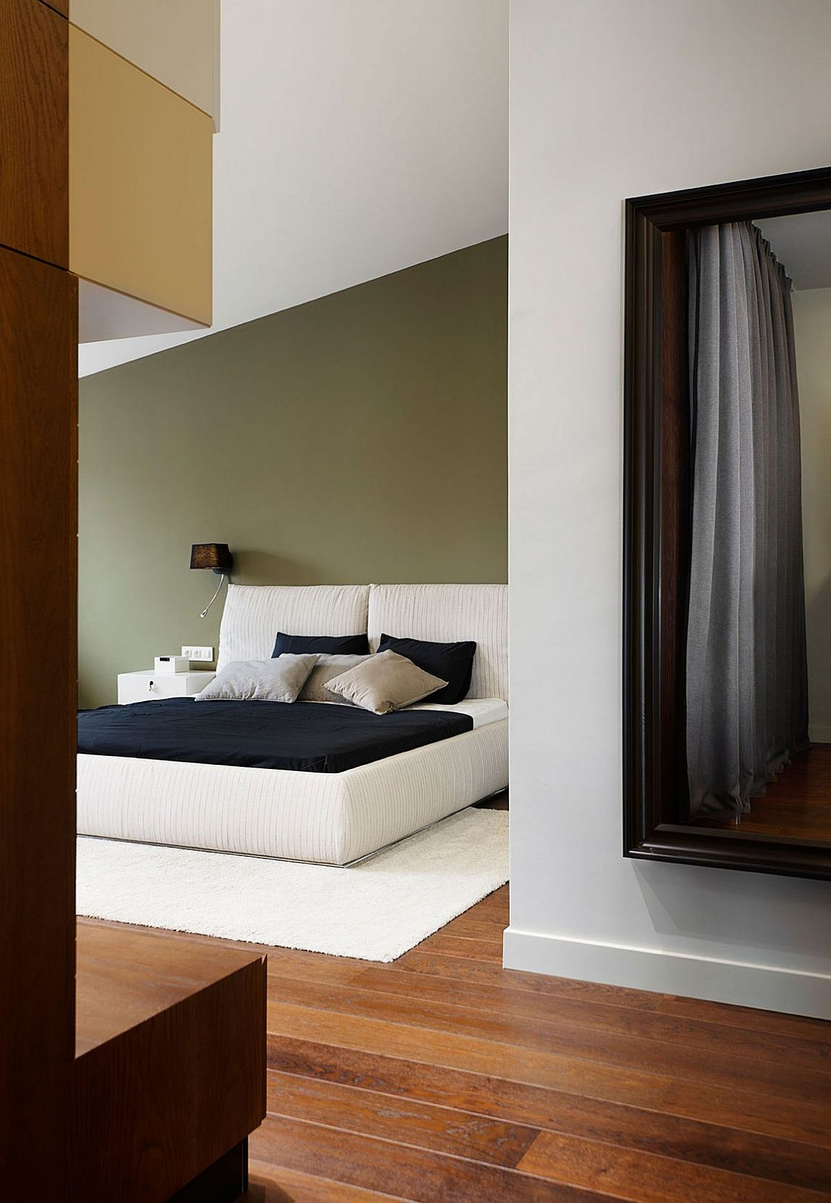 Modern bedroom in greenish-gray and white with minimal style