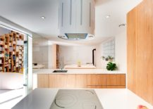 Neutral-color-palette-glass-and-wood-shape-the-stylish-kitchen-217x155