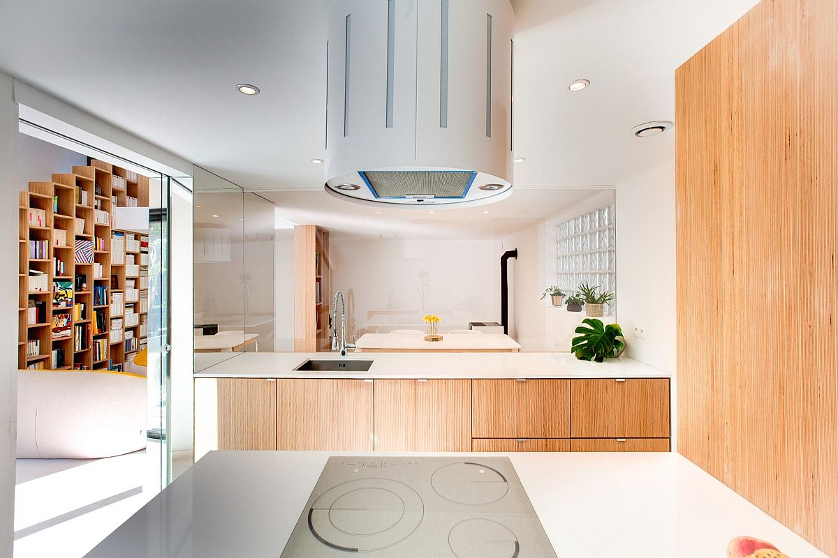 Neutral color palette, glass and wood shape the stylish kitchen