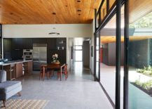 Neutral color scheme and wooden ceiling gives the home that classic Eichler appeal