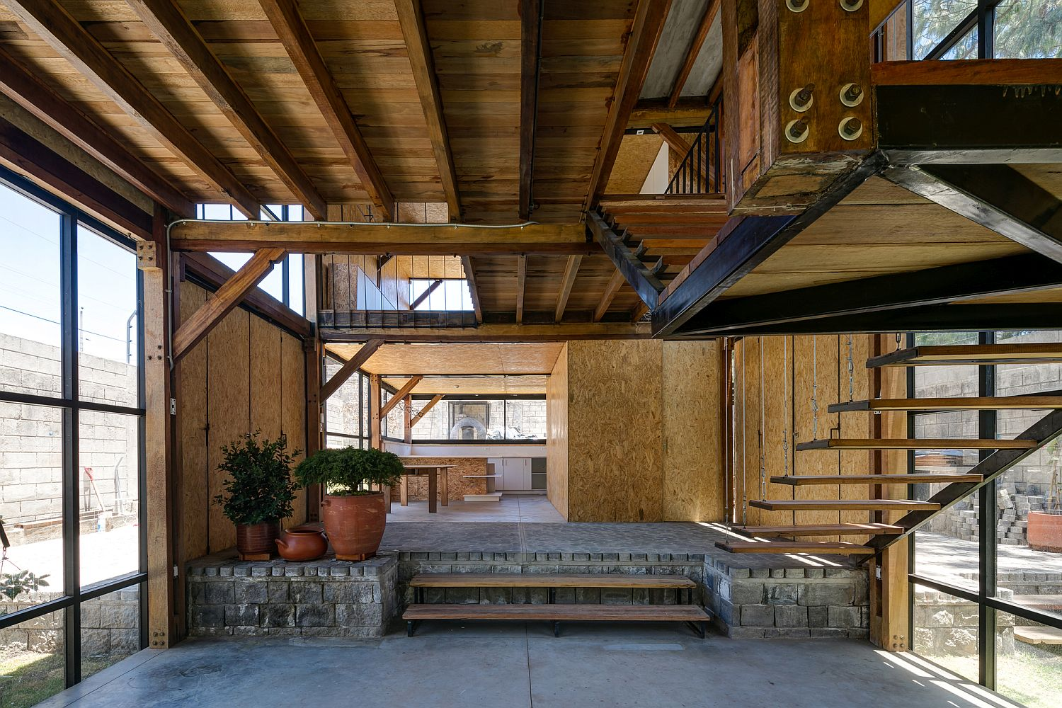 OSB panels, wooden boards and glass windows give the home a uniqe style of its own