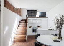 Open plan kitchen and dining space on the basement level of the London home 217x155 Congested Upholsterer's Workshop in London Altered into Multi Level Modern Home