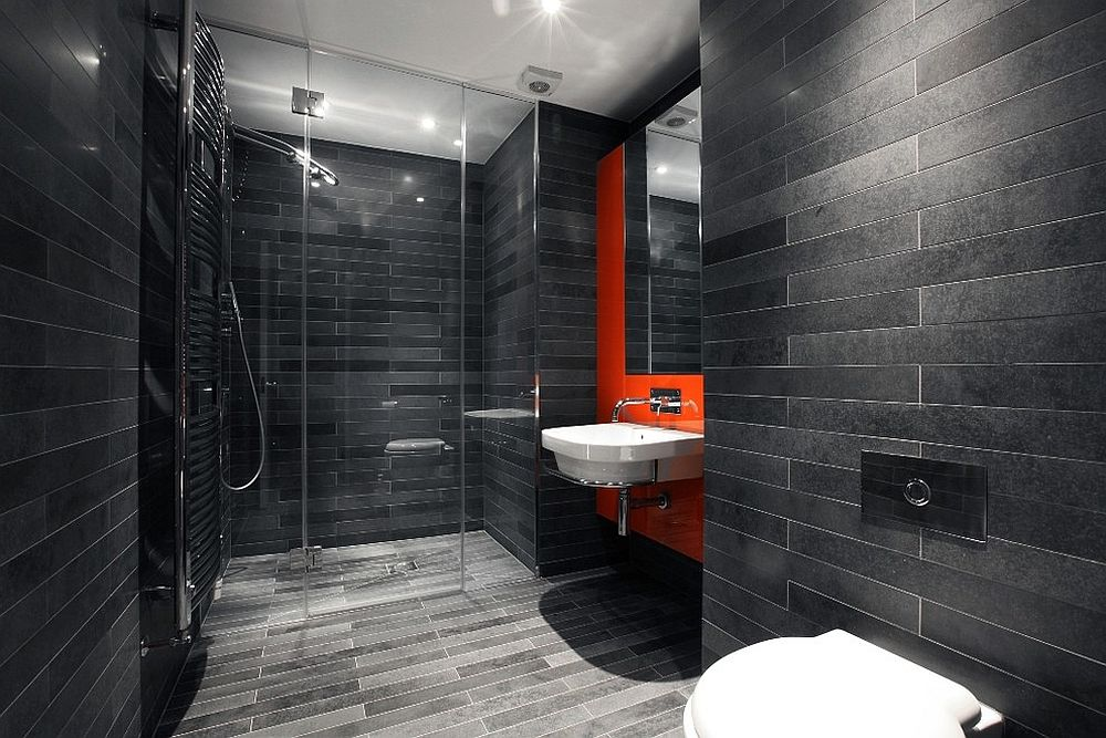 Orange feature wall for minimal bathroom in gray [Design: Morgan Harris Architects Ltd]