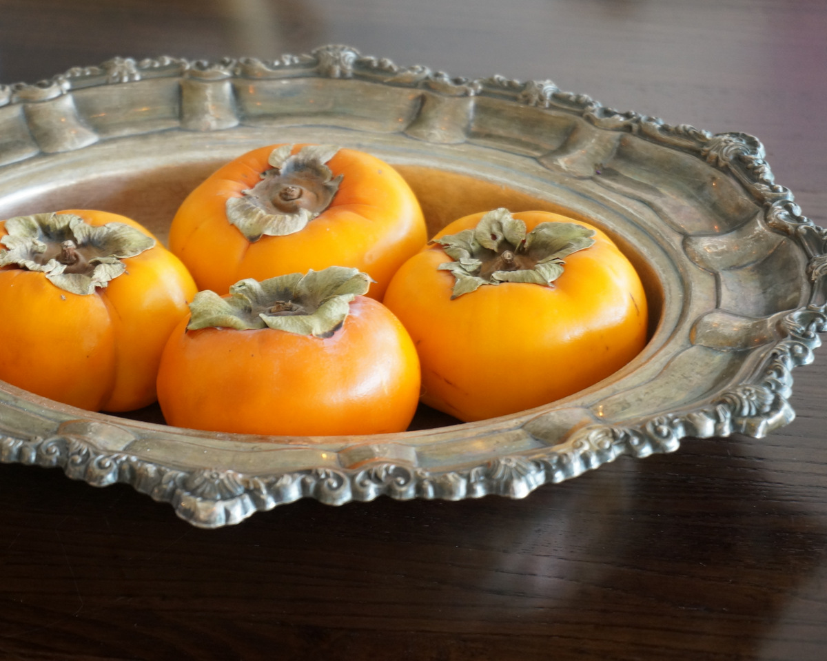 Persimmons centerpiece in silver tray