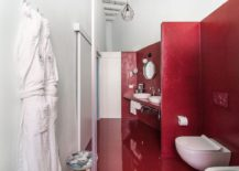 Red-floor-and-walls-in-the-bathroom-present-contrasting-textures-217x155