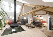 Revamped loft living space of the home in Luxembourg with a glass slab that fliters light to lowerr level