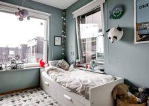 Scandinavian style kids' bedroom in gray with corner bed