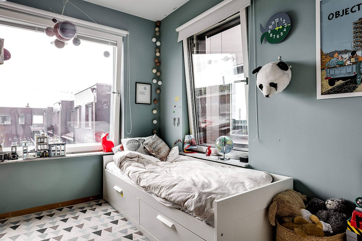 Scandinavian style kids' bedroom in gray with corner bed