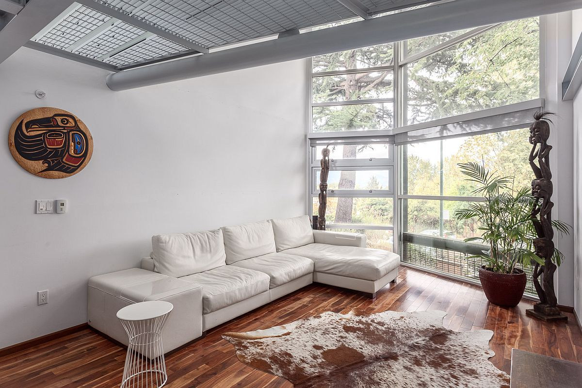 Sectional in the white living room adds to its color scheme