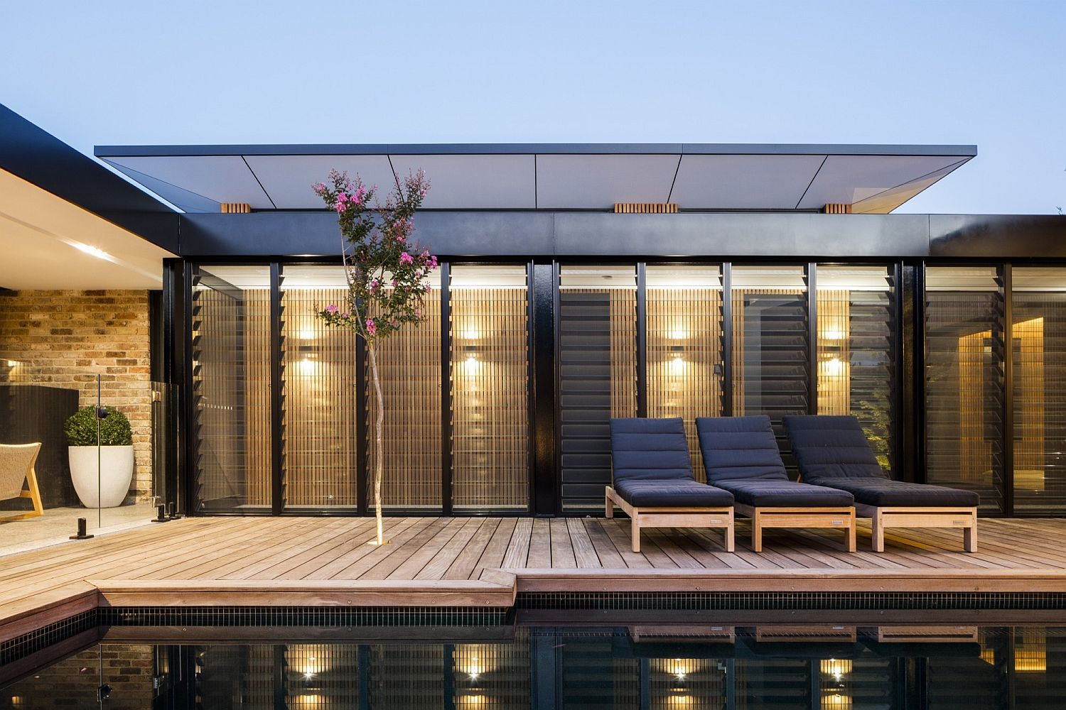 Series of sliding glass doors and additional features transform the Aussie home into an eco-friendly hub
