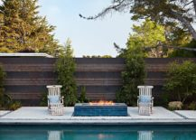 Simple-hangout-next-to-the-pool-with-a-modern-fireplace-217x155