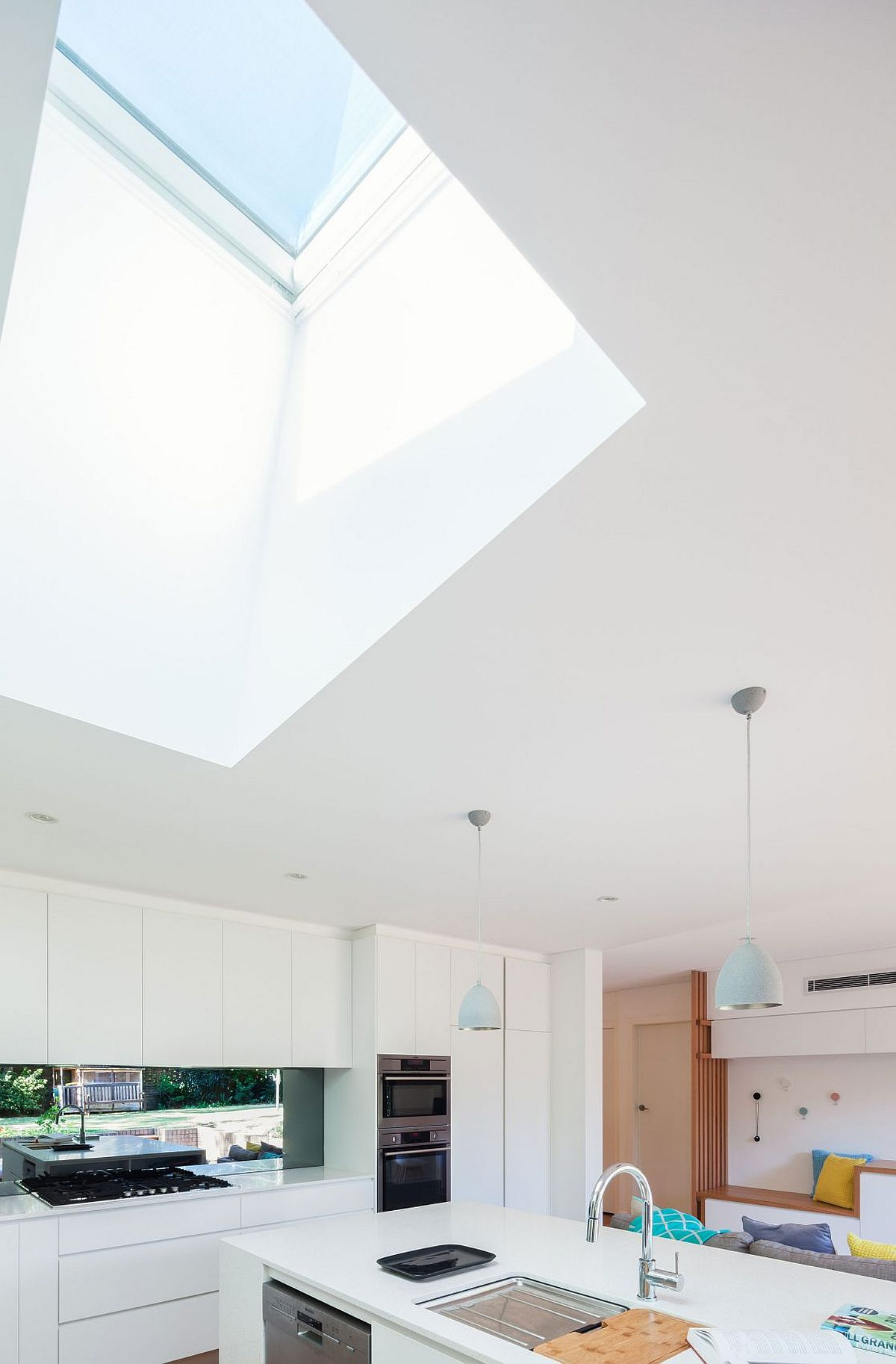 Skylight above the kitchen brings in additional natural light into the living area