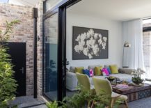 Sliding glass doors connect the interior with the courtyard