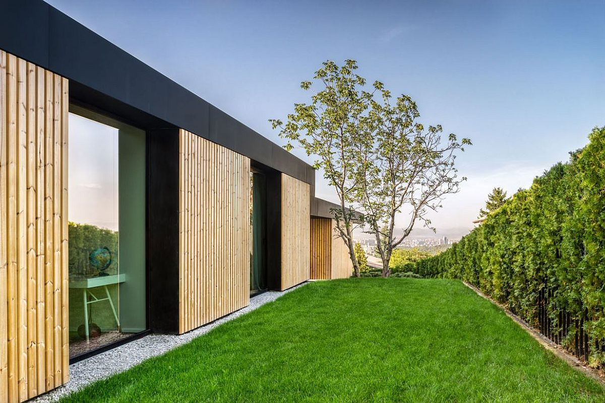Sloped site and green garden of the stylish modern home in Sofia