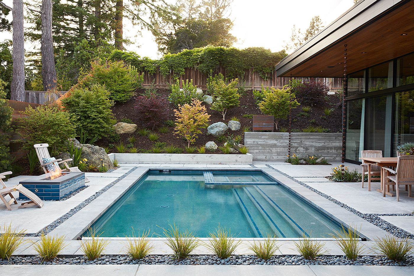 Small backyard pool idea with a smart landscape around it