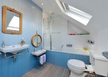 Small beach style bathroom in blue with a hint of gray