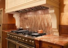 Small-modern-kitchen-with-custom-copper-backsplash-that-also-adds-pattern-217x155
