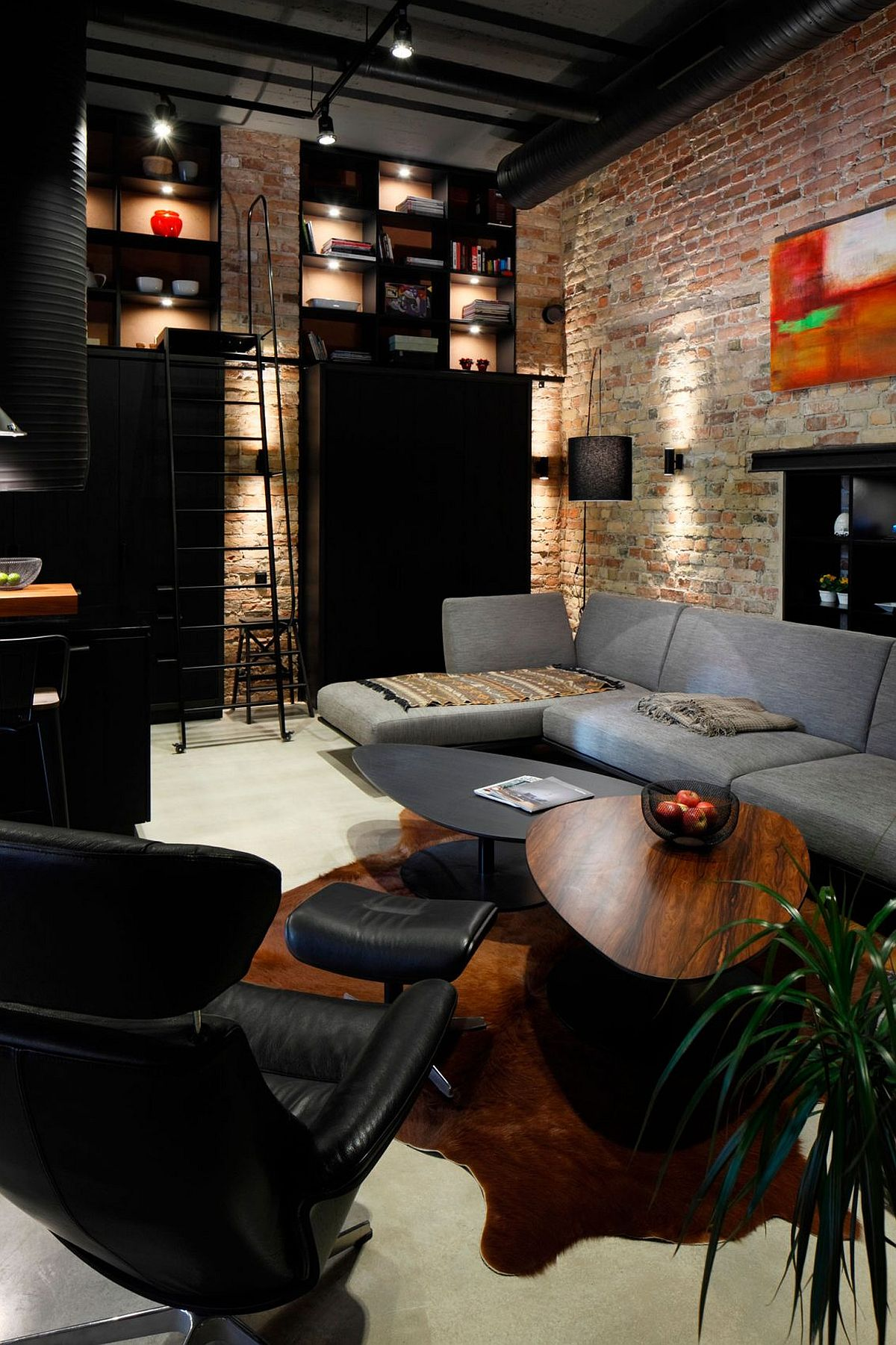 Smart shelving, open duct pipes and brick walls for the modern industrial living room