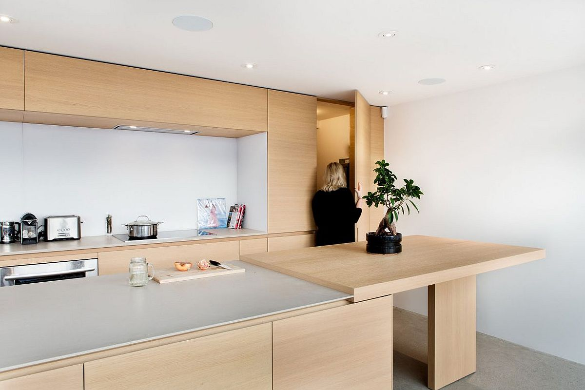Spacious kitchen island and breakfast zone in stone and oak