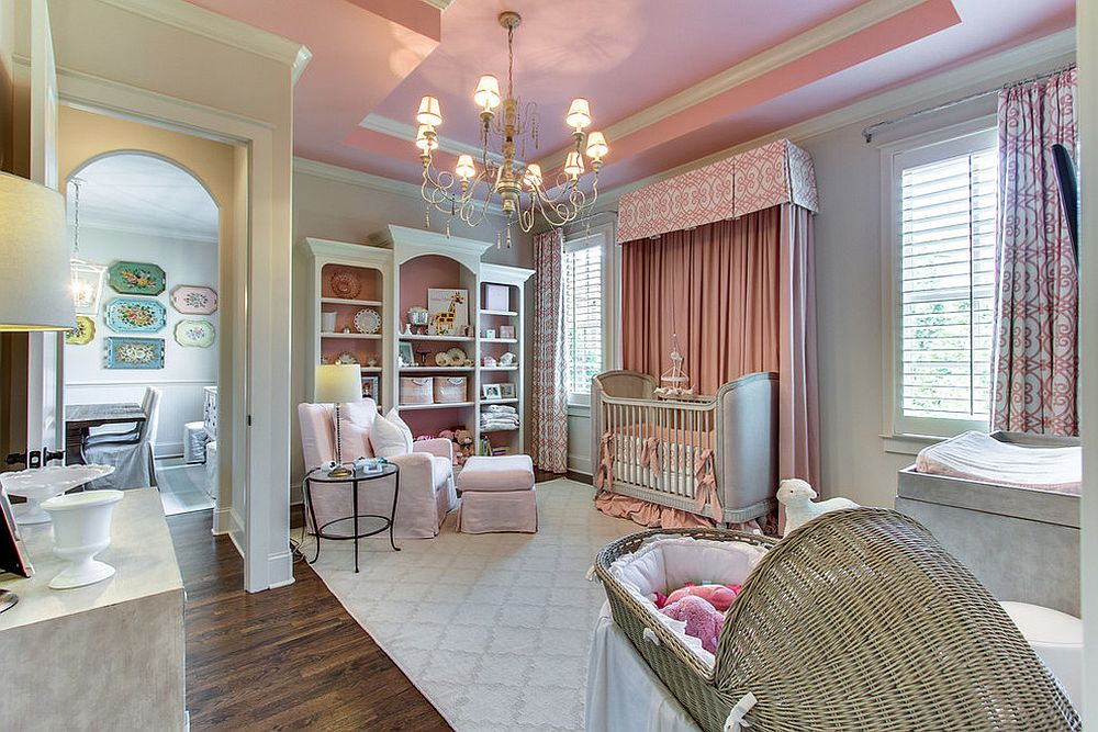 Spacious traditional nursery in gray and pink with play area [From: Tennessee Valley Homes / Showcase Photographers]