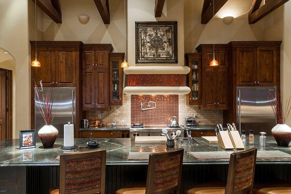 Sparkling copper backsplash for modern kitchen with dining space [Design: Fisher Custom Homes]