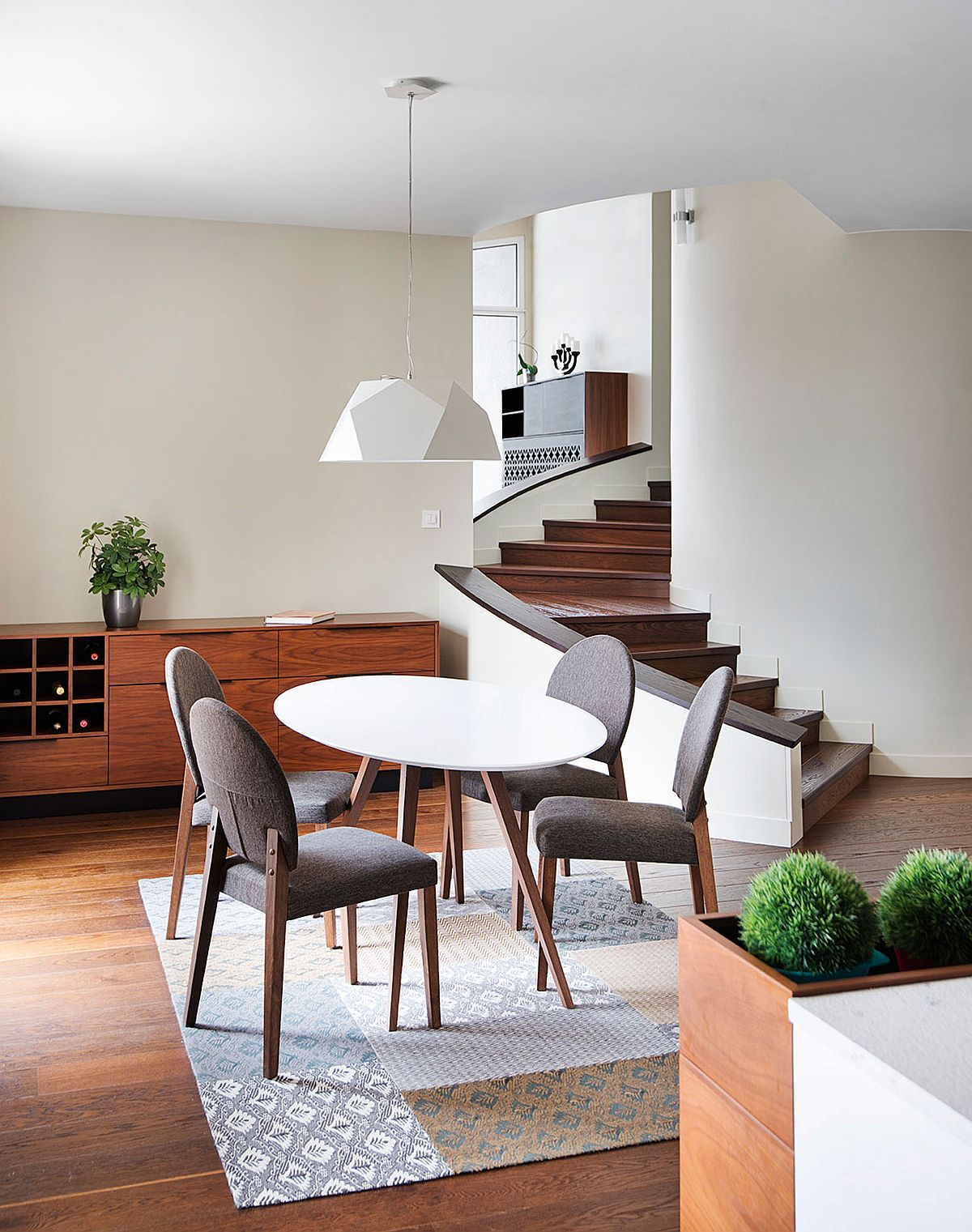 Staircase connects various levels and rooms of the house in a stylish fashion