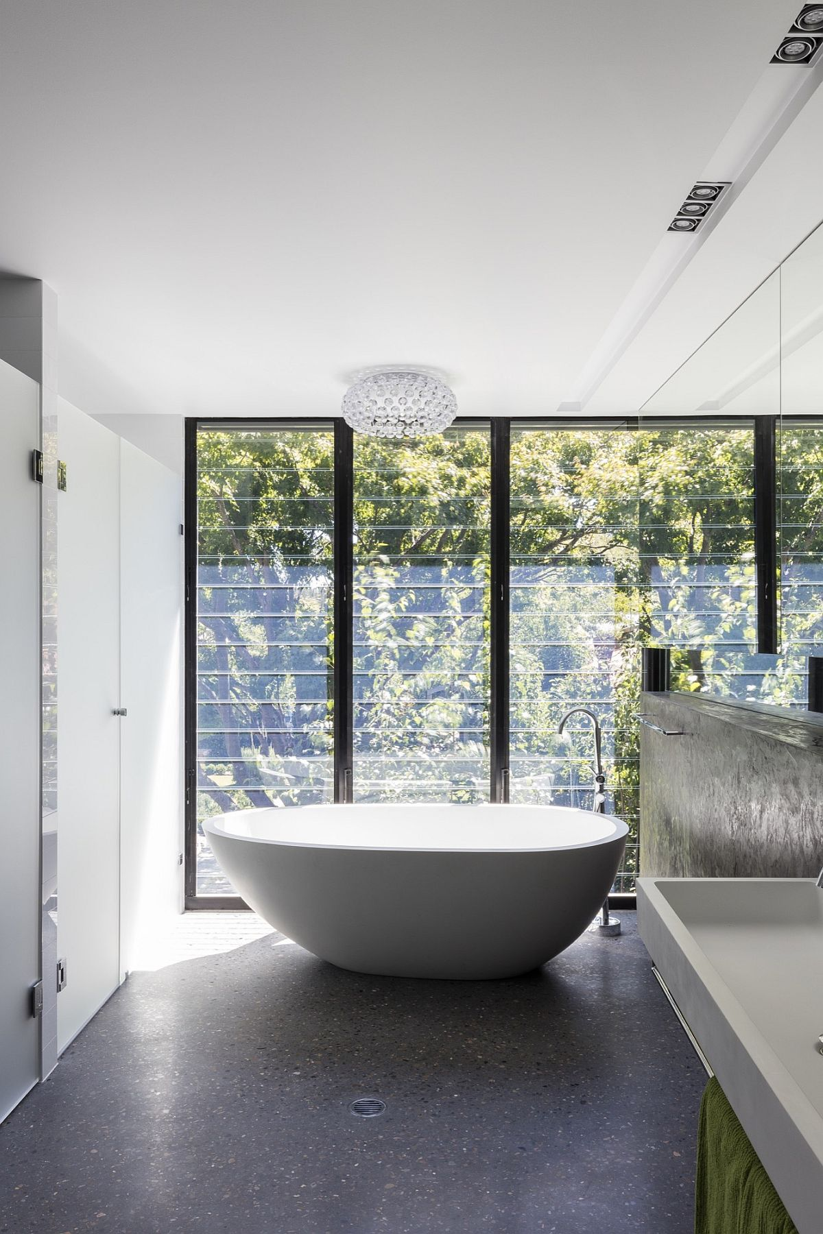 Standalone bathtub and chandelier for the contemporary bath