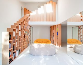 Custom Stepped Bookshelves Steal the Spotlight Inside This Posh Paris Home!
