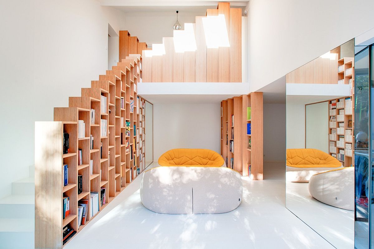 Stepped bookshelves define fabulous home makeover in Paris