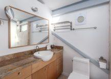 Stone and wood vanity inside the modern duplex loft