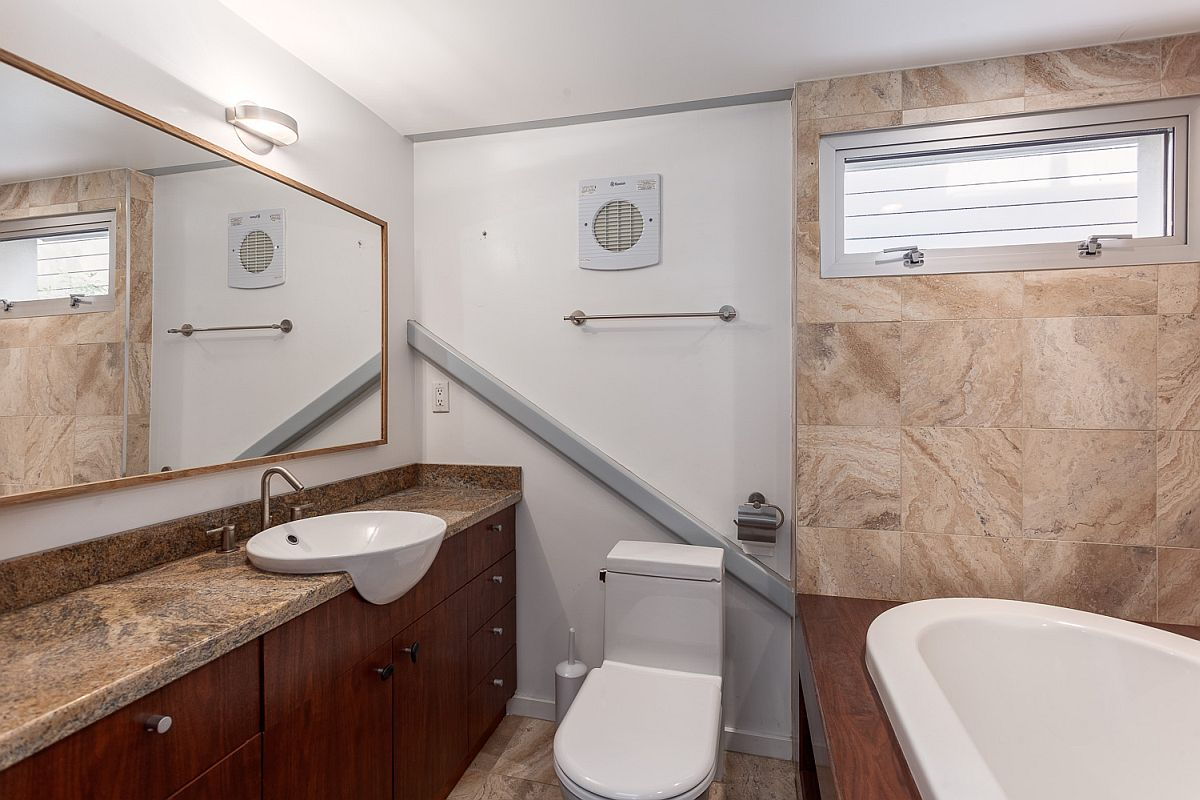 Stone brings warmth and color to the bathroom in white