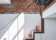 Storage space under the stairs along with perforated top level stairs that bring in natural light