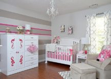 Striped accent wall in gray, white and pink for the modern nursery