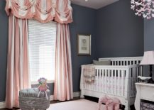 Striped drapes in pink and white enliven traditional nursery in gray