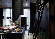 Stylish and dark industrial kitchen of the Latvian apartment