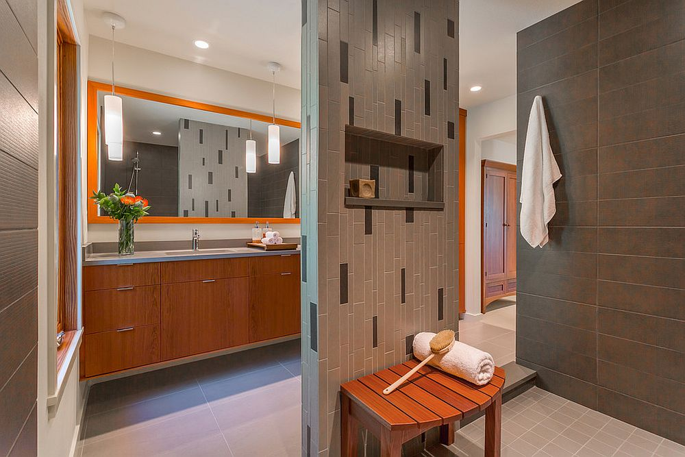 Subtle use of orange in the gray bathroom can make a big difference