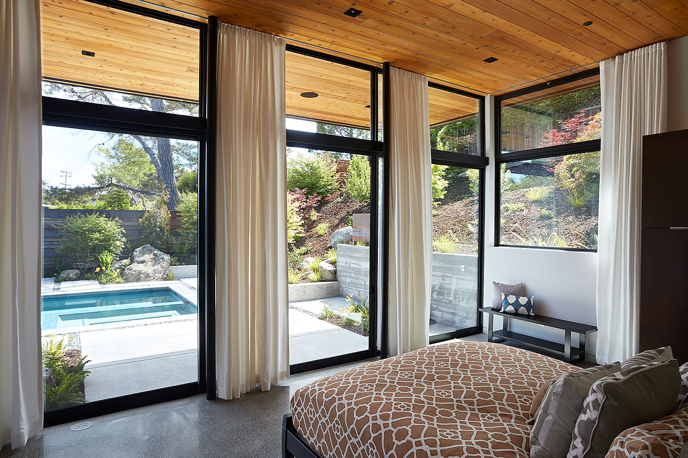 Tall drapes allow the homeowners to switch between privacy and pool view