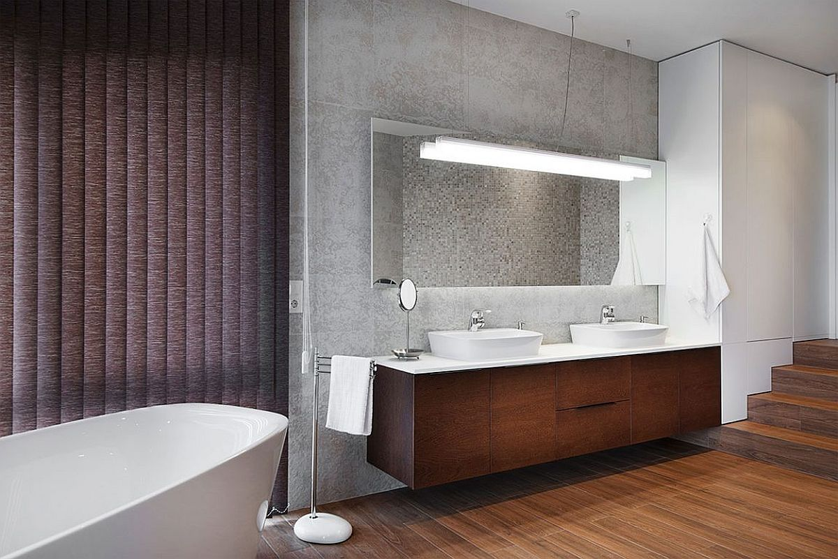 Textured walls, drapes and wooden floor usher in ample contrast in the modern bathroom