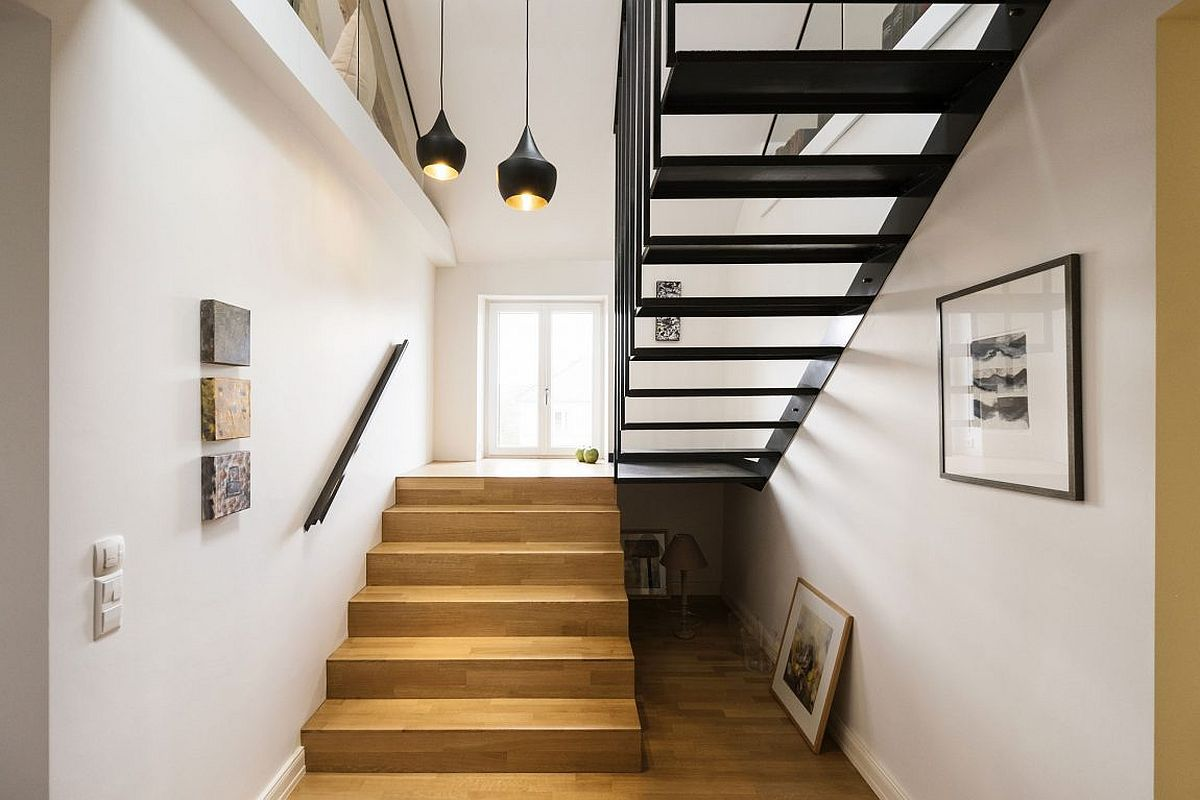 Tom Dixon pendant lights add style to the stairway