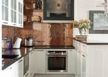 Transitional kitchen in white with a shiny copper backsplash